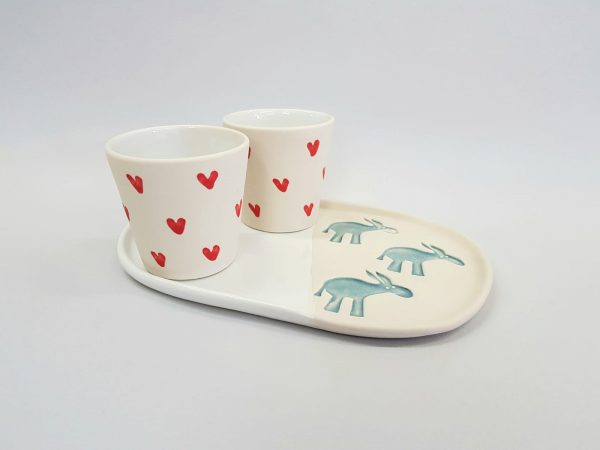 and-made ceramic tray and coffee cups. Product certified for food use.
